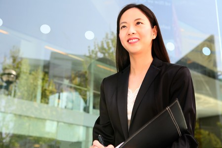 asian office lady: A beautiful asian business woman at office building