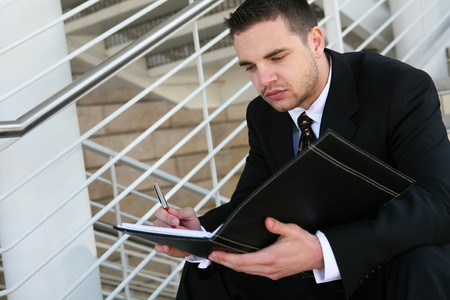 A handsome business man reading at the office photo