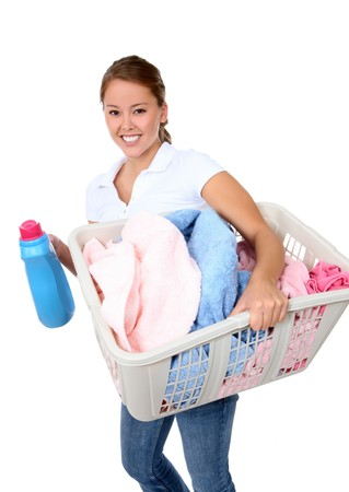 A pretty young woman doing laundry at home photo