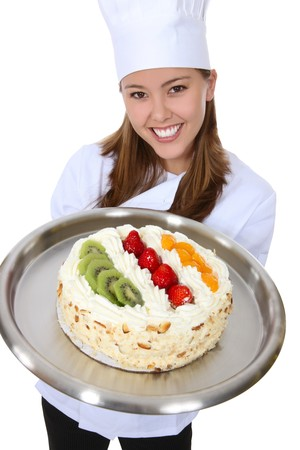 A pretty woman chef holding a dessert cake isolated over white photo