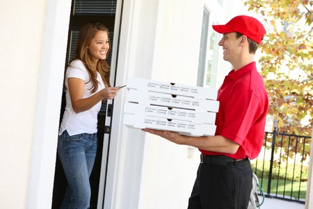delivery driver: A  pizza delivery man giving order to pretty woman