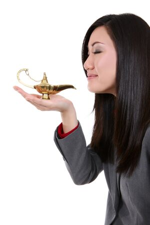 A pretty asian business woman with genie lamp dreaming photo