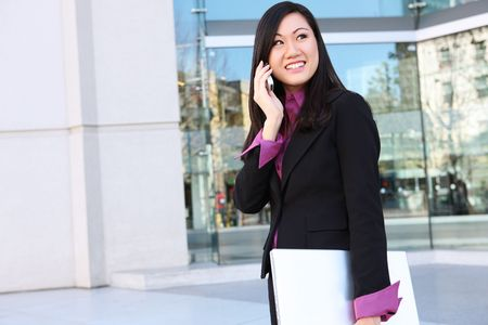 A young, pretty asian woman business woman at the office photo