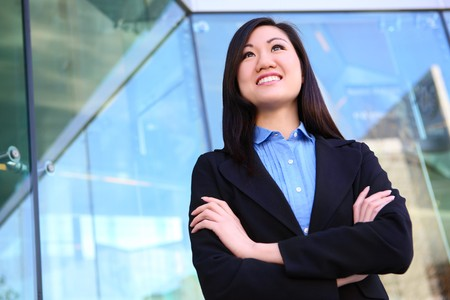 A young, pretty asian business woman at office building Stock Photo