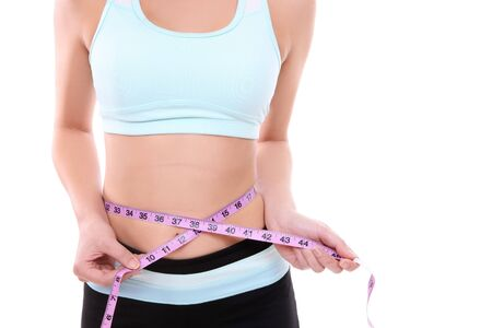 Fit woman measuring her waist after exercising Stock Photo - 4278062