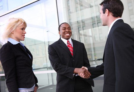 A diverse ethnic business team shaking hands at office building Stock Photo - 4278193