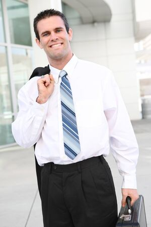 A young, handsome business man at place of work Stock Photo - 4278187