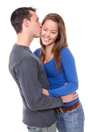 A young happy man and woman couple in love kissing photo