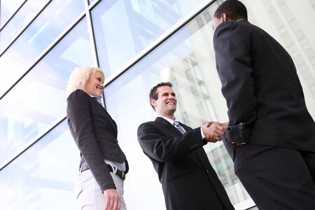 A diverse ethnic business team shaking hands at office building Stock Photo - 4301460