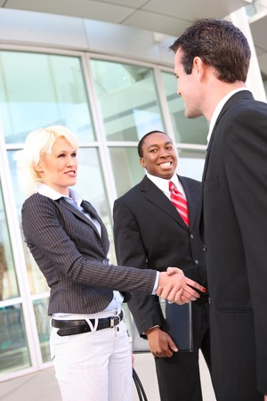 A diverse ethnic business team shaking hands at office building Stock Photo - 4325915