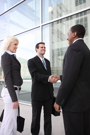 A diverse ethnic business team shaking hands at office building Stock Photo - 4325923