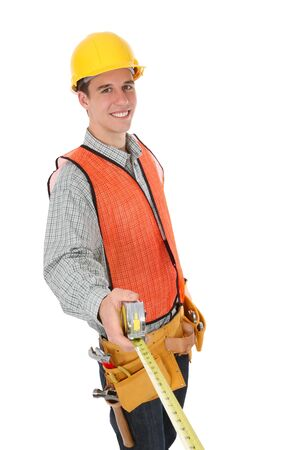A handsome contruction worker with tape measure isolated over white Stockfoto