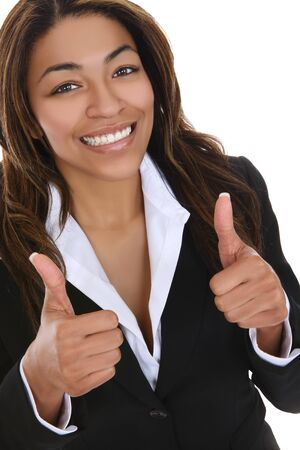 african american businesswoman: A pretty african american business woman indicating success Stock Photo