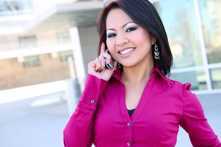 A pretty asian business woman on the cell phone  Archivio Fotografico