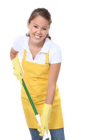 A cute young maid with mop getting ready to clean Фото со стока