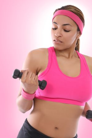 sport wear: A pretty african american woman exercising with weights