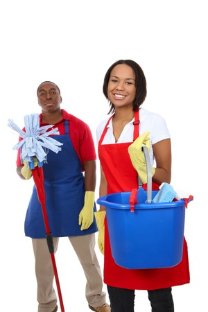 An attractive man and woman holding cleaning supplies photo