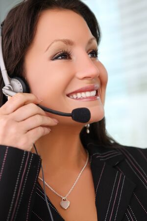 earphone: A pretty business woman with earphone communicating at office