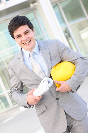 A handsome business man architect on building site