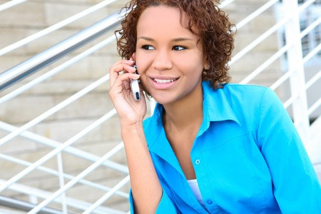 Pretty african american business woman on phone at office Stock Photo - 4561005