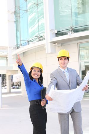 asian architect: An attractive man and woman architect on a construction site