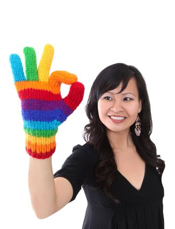 A happy asian woman with rainbow gloves giving success gesture Stock Photo - 4631834