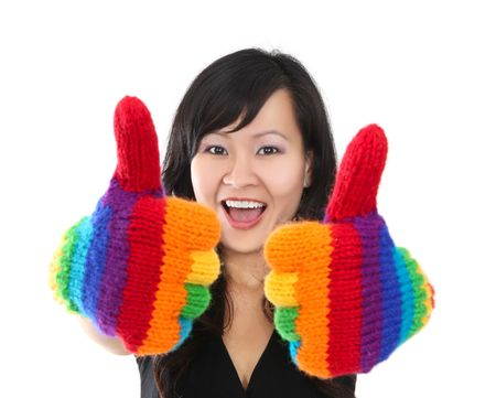 A happy asian woman with rainbow gloves giving thumbs up photo