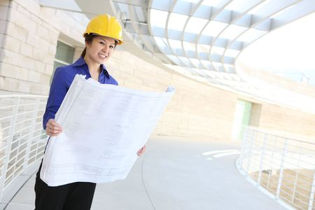 asian architect: A young and pretty asian architect woman at building site