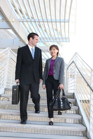 woman stairs: A diverse man and woman business team at their company office building