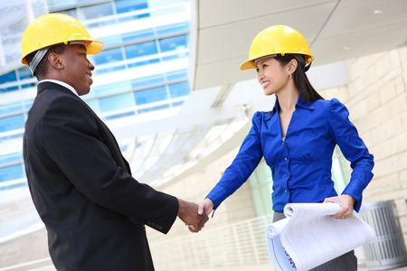A man and woman architect on a construction site photo