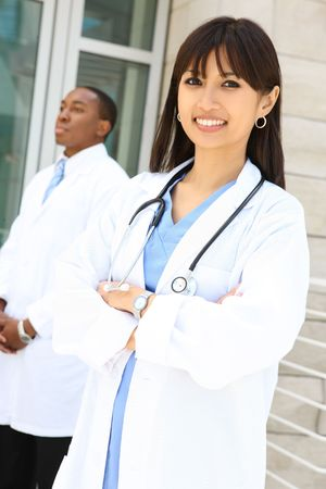 Attractive, diverse medical man and woman team at hospital