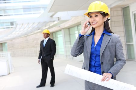 site: A pretty asian woman working as architect on a construction site