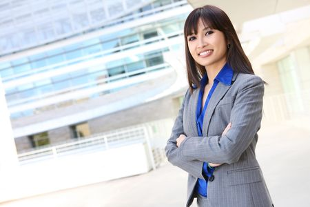 asian office lady: A young, pretty asian business woman at office building  Stock Photo