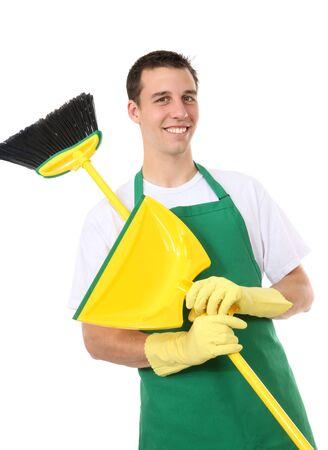 Een knappe jonge man met het reinigen van brem en dustpan Stockfoto