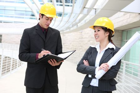 asian architect: Attractive man and woman architects on building construction site