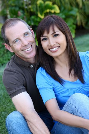 An attractive happy diverse couple in the park photo