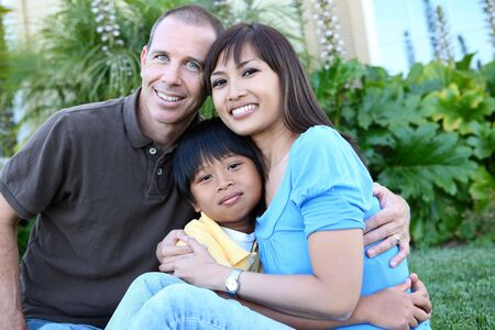 filipino people: Attractive diverse family outside their home on porch Stock Photo