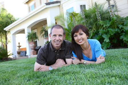 An attractive man and woman husband and wife at home photo