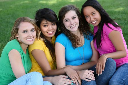 Smiling Happy girl friends in the park with colorful shirts Stock Photo - 5064386