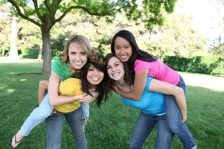 Smiling Happy girl friends in the park with colorful shirts Stock Photo - 5064390