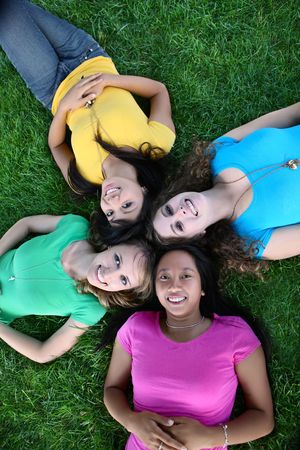 Smiling Happy girl friends in the park with colorful shirts Stock Photo - 5072793