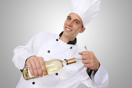 wino: A handsome man chef opening a bottle of wino