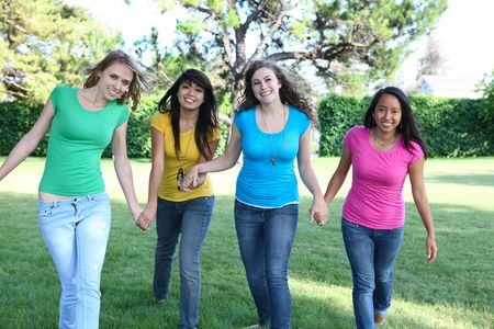 Smiling Happy girl friends in the park with colorful shirts Stock Photo - 5079650