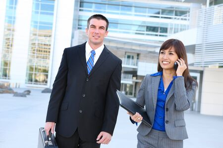 An attractive man and woman business team at the office Stock Photo - 5138552