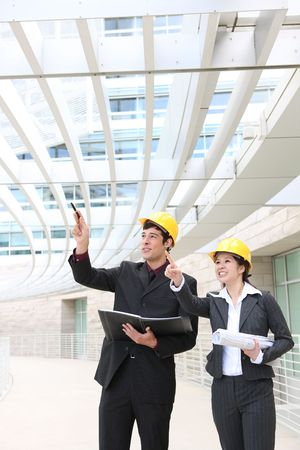 Attractive man and woman architects on building construction site Stock Photo - 5145122