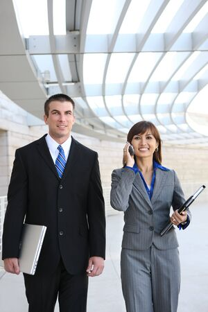 An attractive man and woman business team at the office photo