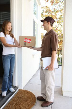 parcel service: A handsome young delivery man delivering a package