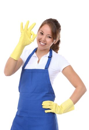 house chores: A pretty asian young woman maid celebrating a success Stock Photo