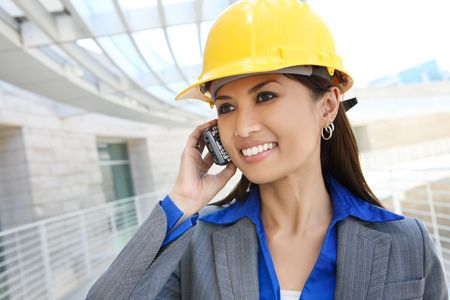 female engineer: A pretty asian woman working as architect on a construction site