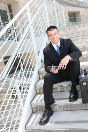 A handsome business man on the stairs at company photo